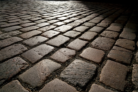 backlight: cobblestones in backlight at sunset