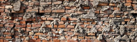 botched: Wall made of bricks in a industrial area in Magdeburg