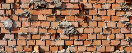 burned out: Wall made of bricks in a industrial area in Magdeburg