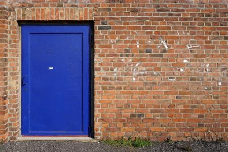 steel door: blue steel door of a factory building in Magdeburg