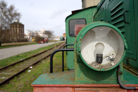 rundown: Headlight of a historic locomotive in the port of Magdeburg