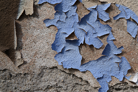 the ageing process: exfoliated facade paint on a wall