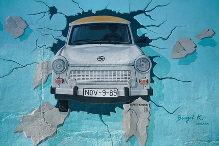 eyesore: BERLIN, GERMANY - MAY 10, 2016: restored mural by the female artist Birgit Kinder at the East Side Gallery in Berlin. Many tourists have left in artworks smearings. These were removed by the restoration. Editorial