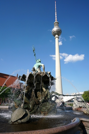 tv tower: BERLIN, GERMANY - MAY 09, 2016: TV tower and Neptune Fountain in Berlin. Two landmark and tourist magnets in downtown Berlin