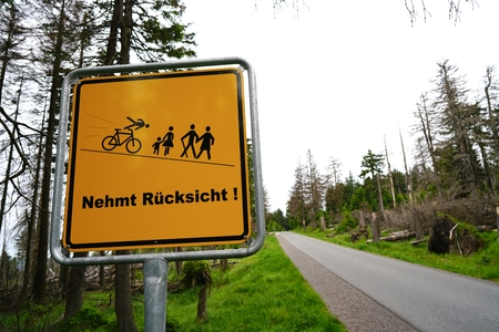 brocken: Sign on the way to the summit of the Brocken with the words take into consideration Stock Photo