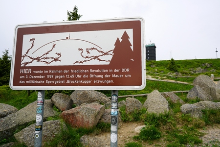enforced: sign at the summit of the Brocken with the indication did here the opening of the wall to the military restricted area was enforced of demonstrators on 03 December 1989 Stock Photo