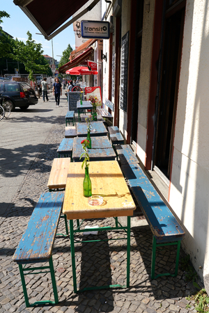 doldrums: BERLIN, GERMANY, MAY 10, 2016: Street Cafe with no guests in Berlin-Kreuzberg.