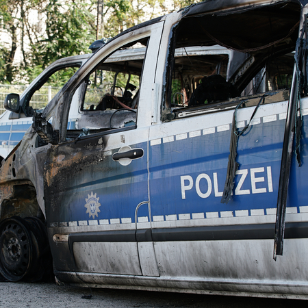 suspected: MAGDEBURG, GERMANY � � September 8, 2016: Burnt-out cars after on of arson attack on police cars in the center of Magdeburg 08.September 2016