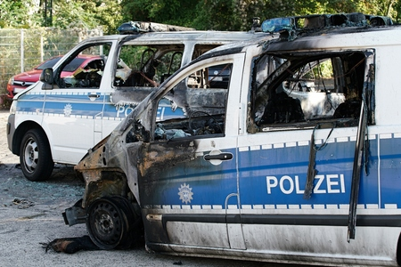 suspected: MAGDEBURG, GERMANY � � September 8, 2016: Burnt-out cars after on of arson attack on police cars in the center of Magdeburg 08 September 2016