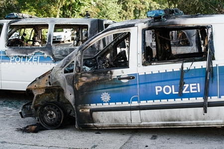 suspected: MAGDEBURG, GERMANY â € September 8, 2016: Burnt-out cars after on of arson attack on police cars in the center of Magdeburg 08.September 2016 Editorial