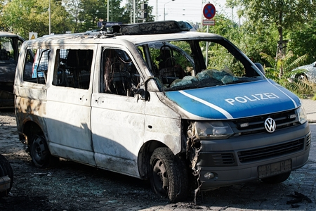 suspected: MAGDEBURG, GERMANY � � �,� September 8, 2016: Burnt-out cars after on of arson attack on police cars in the center of Magdeburg 2016th 08.September Editorial