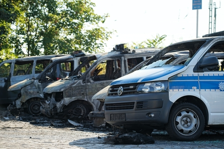deterministic: MAGDEBURG, GERMANY Ã ¢ â,¬ September 8, 2016: Burnt-out cars after on of arson attack on police cars in the center of Magdeburg 2016th 08.September