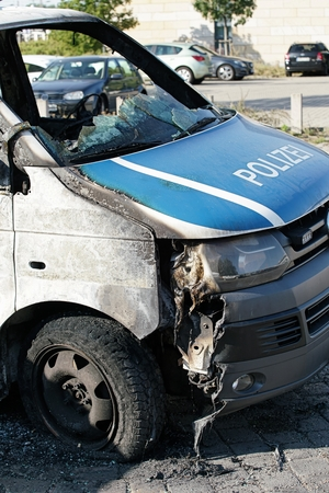 suspected: MAGDEBURG, GERMANY Ã� Ã, �, � � Ã� �,� �, �, �,¬ September 8, 2016: Burnt-out cars after on of arson attack on police cars in the center of Magdeburg 2016th 08th September Editorial
