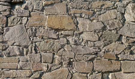 botched: Facade of an old building made of natural stone