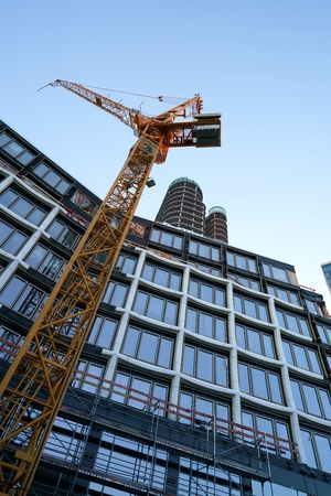 traction: BERLIN, GERMANY - MAY 13, 2016: Construction crane at the construction site of the Upper West. The Upper West is a new hotel and office building on the Kurfürstendamm in Berlin Editorial