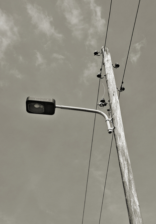 conduction: old street lamp on the road side
