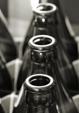 empty bottles in a crate of beer Stock Photo