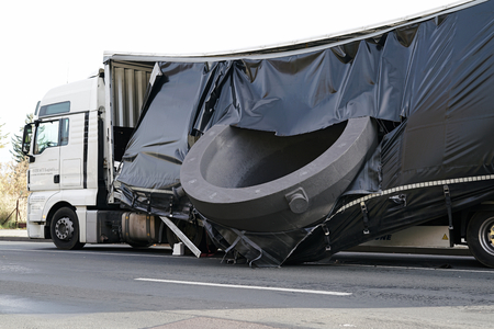 demolish: MAGDEBURG, GERMANY ,November 1, 2016: Accident of a heavy load transporter in the inner city of Magdeburg. The charge slipped and fell on the road Editorial