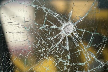 Destroyed window of a railroad wagon Standard-Bild