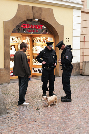 passerby: PRAGUE, CZECH REPUBLIC � � OCTOBER 18, 2016: Policemen in the historic center of Prague check a passerby with his dog Editorial