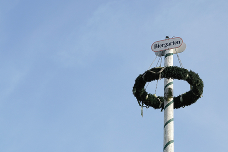 Maypole at a beer garden on the banks of the river Elbe in Magdeburg Stock Photo