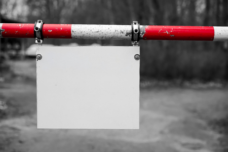 unlabelled: Barrier with a blank signboard Stock Photo