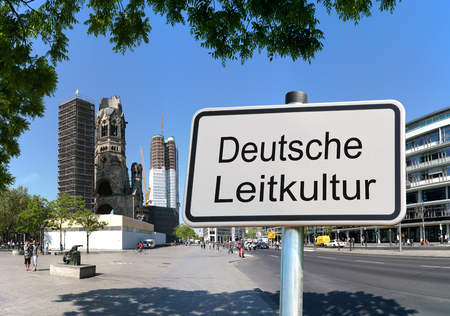 naturalization: BERLIN, GERMANY - MAY 12, 2016: Sign with the words German culture The German Minister of the Interior has drawn up 10 points for a German leading culture All All All All which is to be held by all Germans and asylum. seekers.