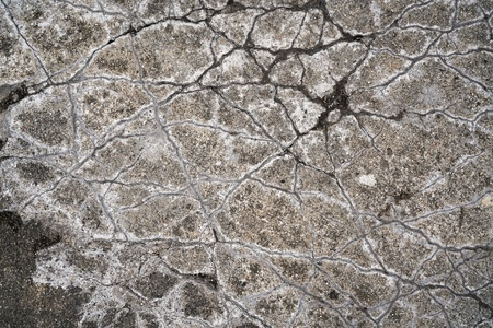 dilapidated wall: Cracks in a concrete floor on a platform