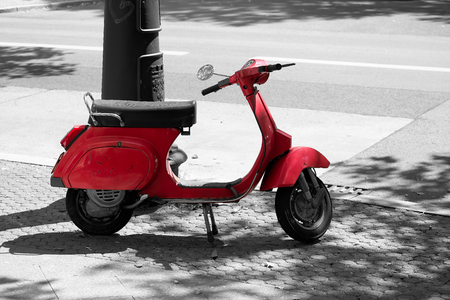 Scooter on the roadside at the Kurfuerstendamm in Berlin