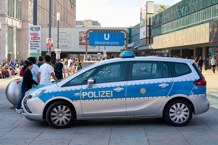 heist: BERLIN, GERMANY - AUGUST 08, 2017: Mobile police station to increase police presence and as a point of contact for crime victims at the Alexanderplatz in Berlin