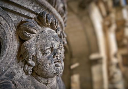 Angel figure made of sandstone at a historic house facade in the old town of Dresden