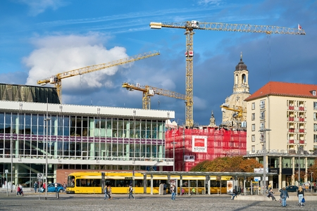 DRESDEN, GERMANY - OCTOBER 11, 2017: Construction cranes on a construction site in the city center of Dresden Editorial
