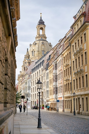 DRESDEN, GERMANY - OCTOBER 11, 2017: Street in the old town of Dresden with the rebuilt Frauenkirche in the background Editorial