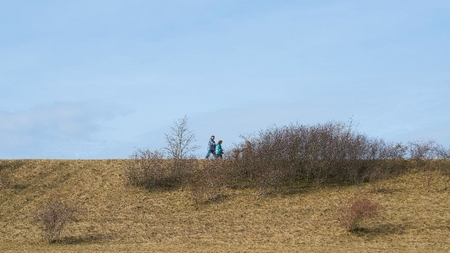 BARLEBEN, GERMANY - MARCH 11, 2018: Walkers on the dike of the Mittelland Canal in Barleben near Magdeburg