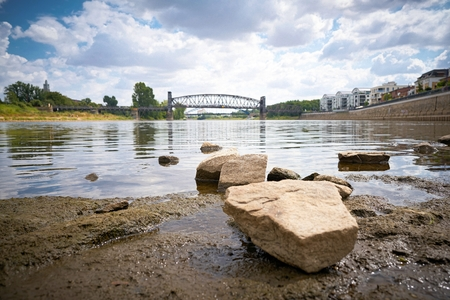 Bank of the river Elbe at the Cathedral rock in Magdeburg at low tide Banco de Imagens