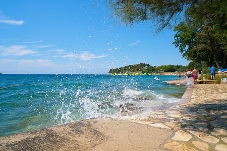 POREC, CROATIA - JULY 17, 2018: Beach on the Adriatic Sea Zelena Laguna near Porec in Croatia Editorial