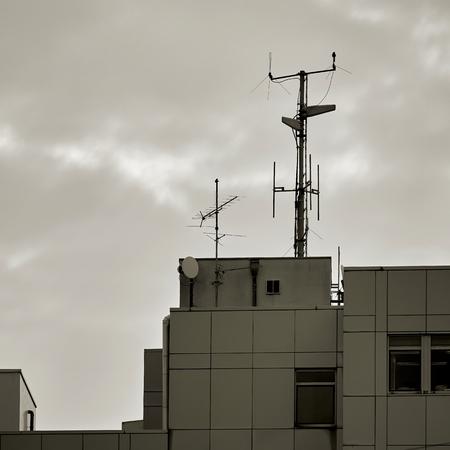 Antennas on the roof of an office building Stock Photo