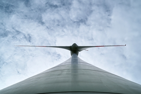 View from below of the rotor blades of a wind turbine