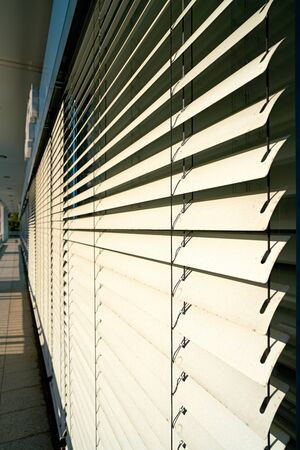 Venetian blind as a sunscreen on the window of an office building in Berlin