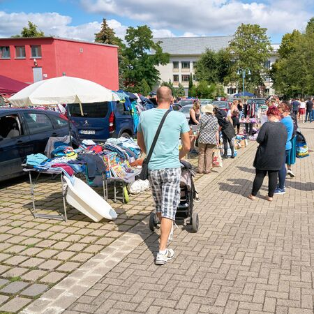 MAGDEBURG, GERMANY - AUGUST 04, 2019: Visitors on a popular flea market in downtown Magdeburg on a Sunday Editorial