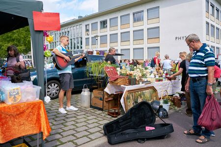 MAGDEBURG, GERMANY - AUGUST 04, 2019: Music on a popular flea market in downtown Magdeburg on a Sunday