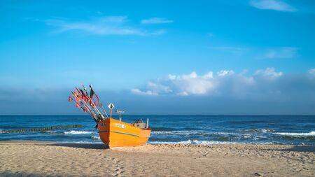 REWAL, POLAND - SEPTEMBER 04, 2019: Fishing boat on Baltic sea beach at Rewal in Poland
