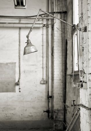 Lamp at a workplace in an abandoned workshop