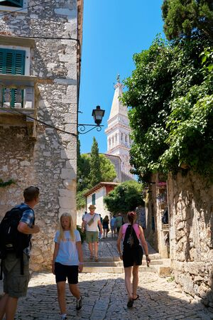 ROVINJ, CROATIA - JULY 18, 2018: Tourists from all over the world at the historic old town of Rovinj in Croatia Editöryel