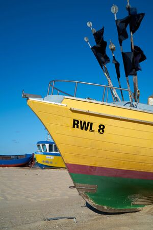 REWAL, POLAND - SEPTEMBER 02, 2019: Fishing boats on the beach at the Polish Baltic coast in Rewal
