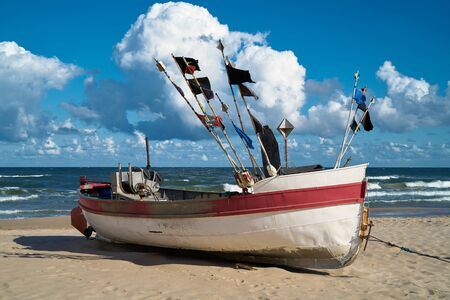 Fishing boat on the beach at the Baltic sea at Rewal in Poland