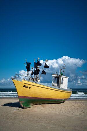 REWAL, POLAND - SEPTEMBER 02, 2019: Fishing boat on the beach at the Polish Baltic coast near Rewal