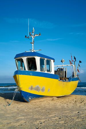 Fishing boat on the beach of the Polish Baltic coast near Rewal 写真素材 - 137826148
