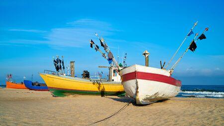 Fishing boats on the beach of the Polish Baltic coast near Rewal 写真素材