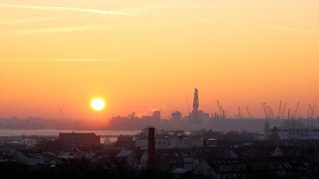 Sunrise at the port of Rostock seen from Warnemünde